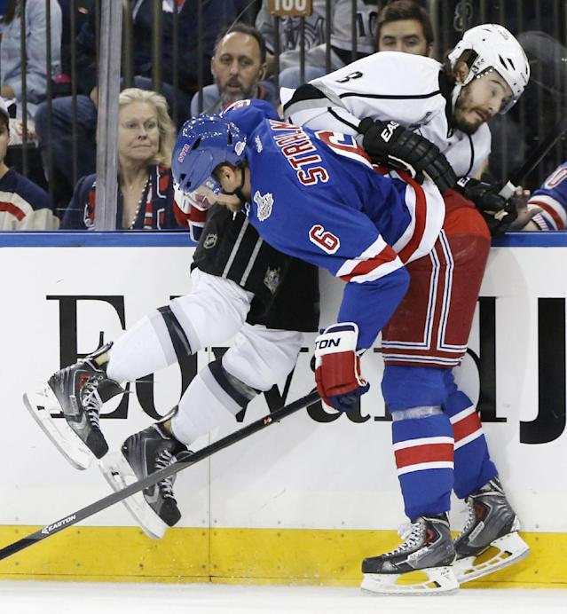 New York Rangers defenseman Anton Stralman (6) collides with Los Angeles Kings defenseman Drew Doughty (8) in the first period during Game 4 of the NHL hockey Stanley Cup Final, Wednesday, June 11, 2014, in New York. (AP Photo/Kathy Willens)