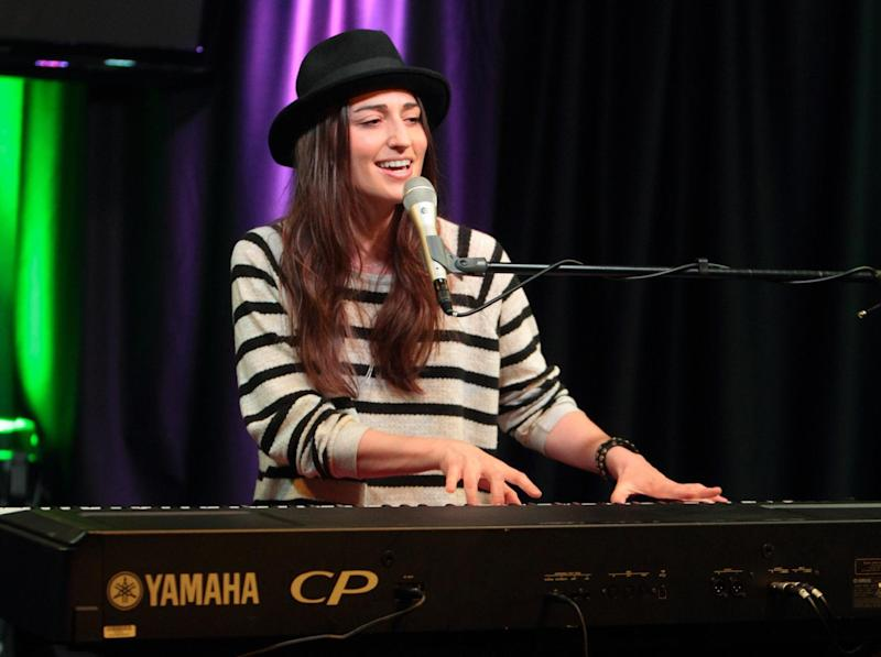 """FILE - In this April 30, 2013 file photo, singer-songwriter Sara Bareilles visits radio station Mix 106 Performance Theater, in Philadelphia. Bareilles says though she doesn't think Katy Perry's """"Roar"""" steals from her song """"Brave,"""" she's enjoying her tune's newfound success because of the chatter. """"I was stoked. I was like, 'Great,'"""" Bareilles said in an interview Tuesday, Sept. 17, 2013. (Photo by Owen Sweeney/Invision/AP, File)"""