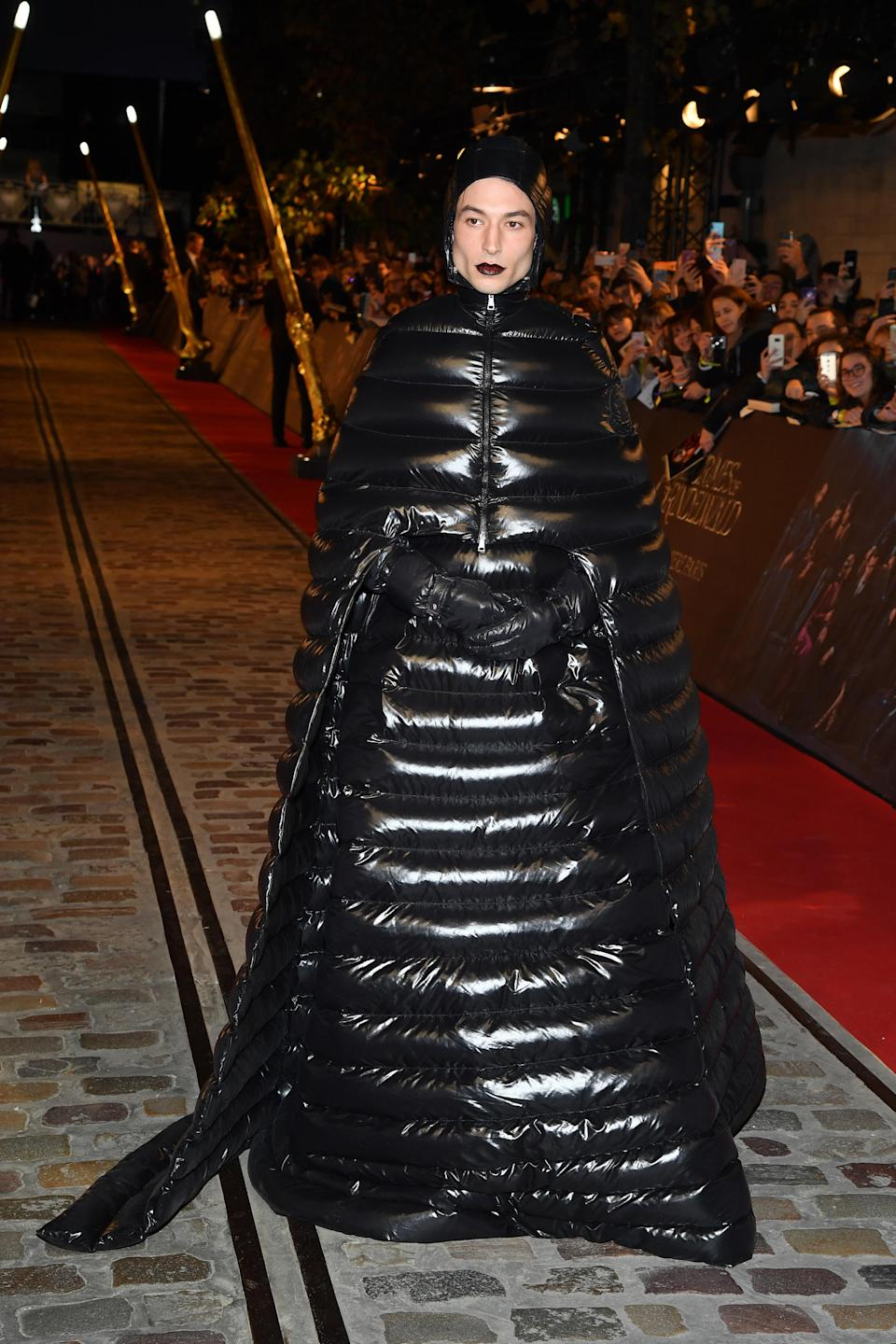 <p>Ezra Miller divided the Internet after wearing a £3,565 puffer dress from the Moncler x Pierpaolo Piccioli collaboration on the red carpet. Many described the look as a Walnut Whip while some believe he resembled a caterpiller. Not our words… <em>[Photo: Getty]</em> </p>