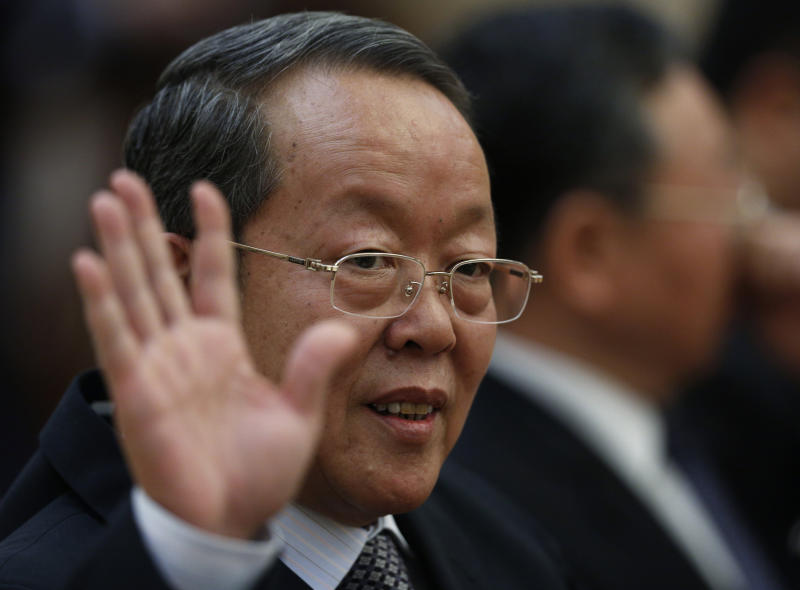 China's Director of the Hong Kong and Macau Affairs Office Wang Guangya waves to reporters before a meeting at the Great Hall of the People as part of the 18th Communist Party Congress in Beijing, Friday, Nov. 9, 2012. (AP Photo/Vincent Yu)