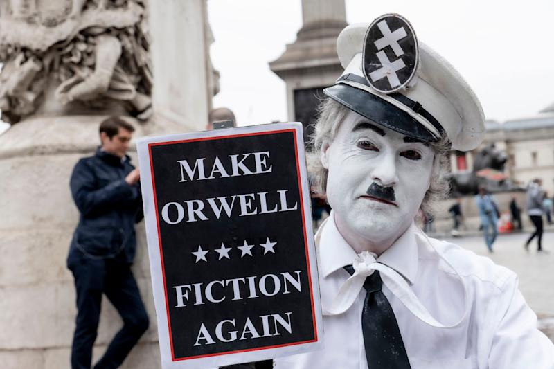 "A male mime artist with a placard reading ""Make Orwell Fiction Again"" during a demonstration against U.S. President Donald Trump's state visit to the U.K. (Photo: Sam Mellish / In Pictures via Getty Images)"