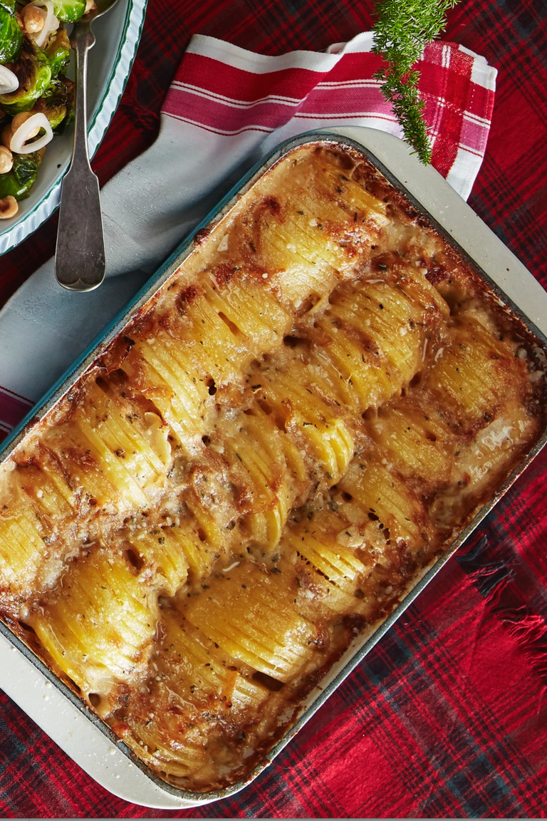 """<p>Guests won't be able to get enough of this decadent and cheesy potato gratin, that will pair perfectly with just about any main course.</p><p><strong><a href=""""https://www.countryliving.com/food-drinks/a29626417/hasselback-potato-gratin-recipe/"""" rel=""""nofollow noopener"""" target=""""_blank"""" data-ylk=""""slk:Get the recipe"""" class=""""link rapid-noclick-resp"""">Get the recipe</a>.</strong></p><p><strong><a class=""""link rapid-noclick-resp"""" href=""""https://www.amazon.com/Pyrex-Basics-Baking-Dishes-Oblong/dp/B01LXV2RWL/?tag=syn-yahoo-20&ascsubtag=%5Bartid%7C10050.g.1078%5Bsrc%7Cyahoo-us"""" rel=""""nofollow noopener"""" target=""""_blank"""" data-ylk=""""slk:SHOP BAKING DISHES"""">SHOP BAKING DISHES</a><br></strong></p>"""