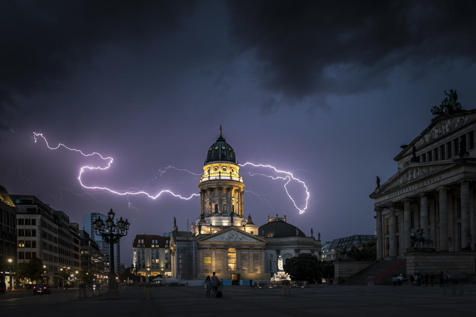 BERLIN, GERMANY - JULY 27: Lightning strikes behind the German Chruch (Deutscher Dom) and the Konzerthaus at the Gendarmenmarkt on July 27, 2017 in Berlin, Germany. (Photo by Florian Gaertner/Photothek via Getty Images)