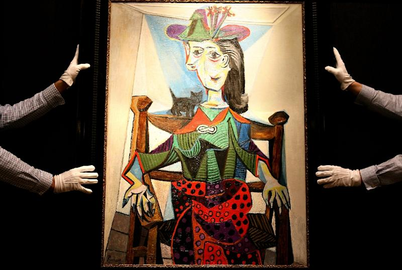 Picasso's paintings go for fortunes -- including some of the many portraits he did of his mistress and muse Dora Maar (AFP Photo/BEN STANSALL)
