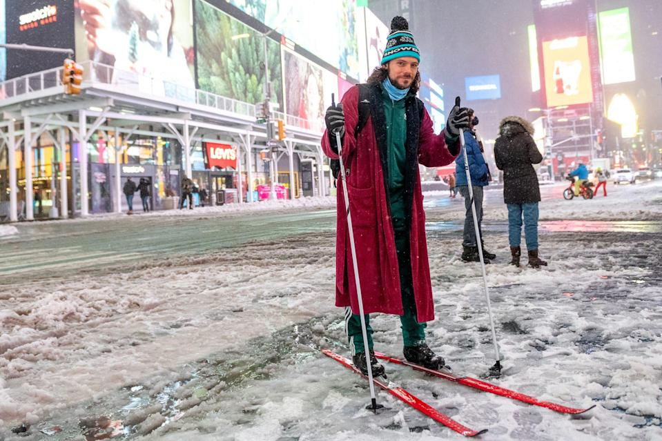 <p>A man makes his way through New York City's Times Square by cross country skis.</p>