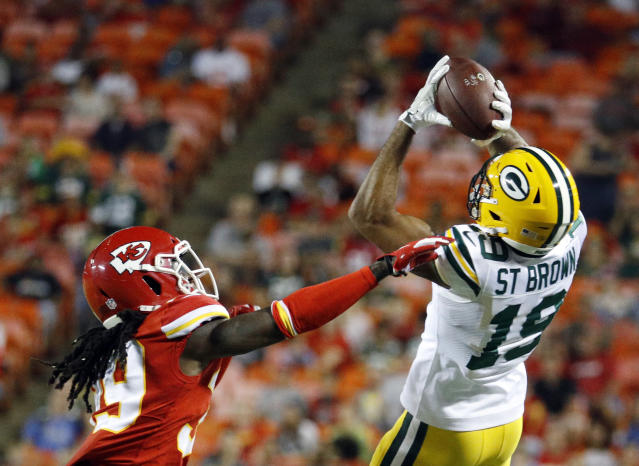Green Bay Packers wide receiver Equanimeous St. Brown (19) makes a catch over Kansas City Chiefs cornerback Tremon Smith (39) during the first half of an NFL preseason football game in Kansas City, Mo., Thursday, Aug. 30, 2018. (AP Photo/Charlie Riedel)
