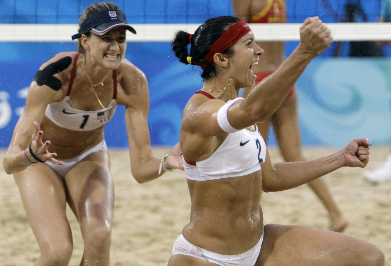 FILE - In this Aug. 21, 2008, file photo, United States' Misty May-Treanor, right, and Kerri Walsh celebrate after the gold medal women's beach volleyball match against China in the 2008 Olympics in Beijing. Beach and indoor volleyball have little in common except a few rules, a few athletes and a national governing body that beach players say hasn't always looked out for the sandier, sexier and more lucrative side of the sport. Now, with qualifying for the 2012 Olympics coming up, they want more control over their game. (AP Photo/Natacha Pisarenko, File)