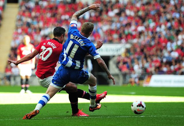 LONDON, ENGLAND - AUGUST 11: Robin van Persie of Manchester United scoring the second goal during the FA Community Shield match between Manchester United and Wigan Athletic at Wembley Stadium on August 11, 2013 in London, England. (Photo by Jamie McDonald/Getty Images)