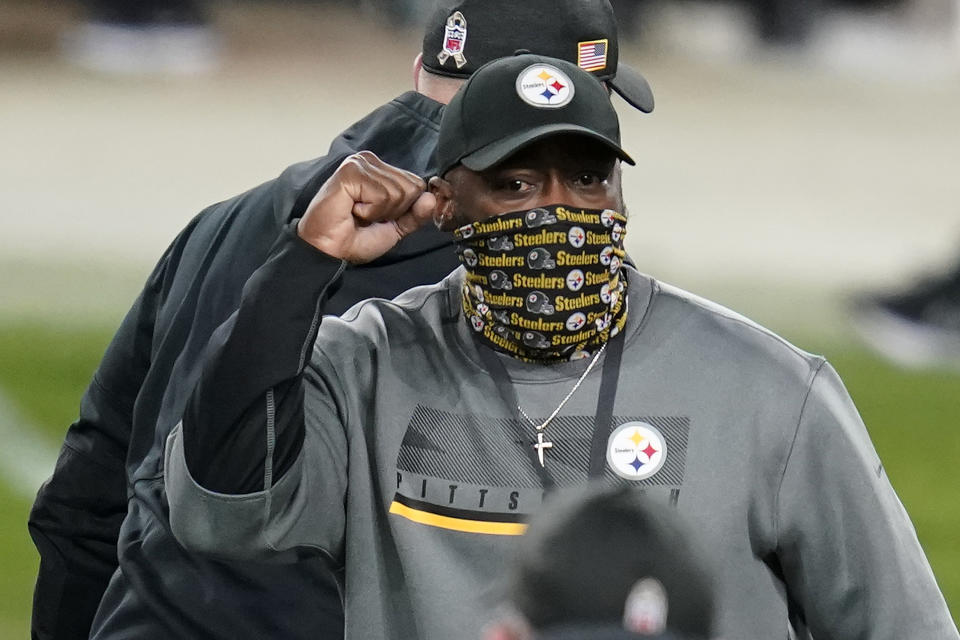 Pittsburgh Steelers head coach Mike Tomlin celebrates as he walks off the field following a win over the Cincinnati Bengals during an NFL football game, Sunday, Nov. 15, 2020, in Pittsburgh. (AP Photo/Keith Srakocic)