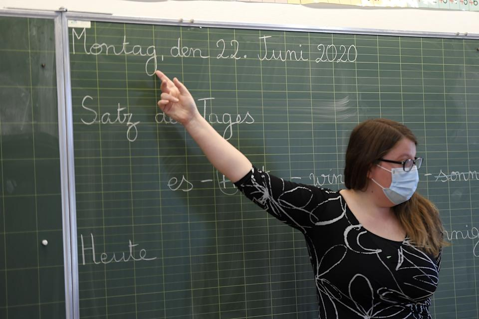 A teacher gives a lesson to the pupils at the Ziegelau elementary school in Strasbourg, eastern France, as primary and middle schools reopen in France on June 22, 2020. - After six weeks of unsteady school sessions and more than three months of class at home to fight against the spread of the new coronavirus Covid-19, French pupils and middle school students return to class on June 22, thanks to a lighter health protocol. (Photo by FREDERICK FLORIN / AFP) (Photo by FREDERICK FLORIN/AFP via Getty Images)