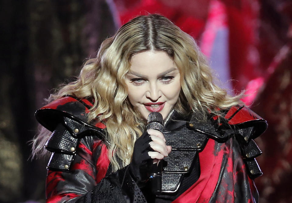 """FILE - In this Feb. 20, 2016 file photo, Madonna performs during the Rebel Heart World Tour in Macau.  The executive producer of Sunday's Billboard Music Awards is defending the decision to have Madonna pay homage to Prince, which has been met with some criticism online and sparked a Change.org petition. """"Listen, I think everybody is entitled to their opinion and everyone can have their own opinion, but I will say that we are honored and could not be more excited for Madonna to be on the show and to pay tribute to someone that was her friend and her peer and her colleague,"""" Mark Bracco said in an interview with The Associated Press on Tuesday, May 17, 2016. """"I think it's going to be fantastic."""" (AP Photo/Kin Cheung, File)"""