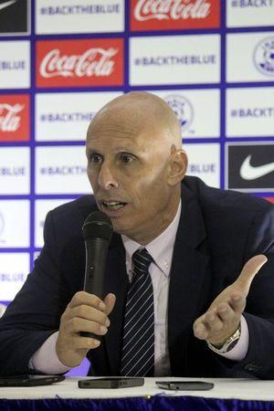 Indian coach Stephen Constantine talks to reporters after their World Cup qualifying soccer match against Guam in Bengaluru