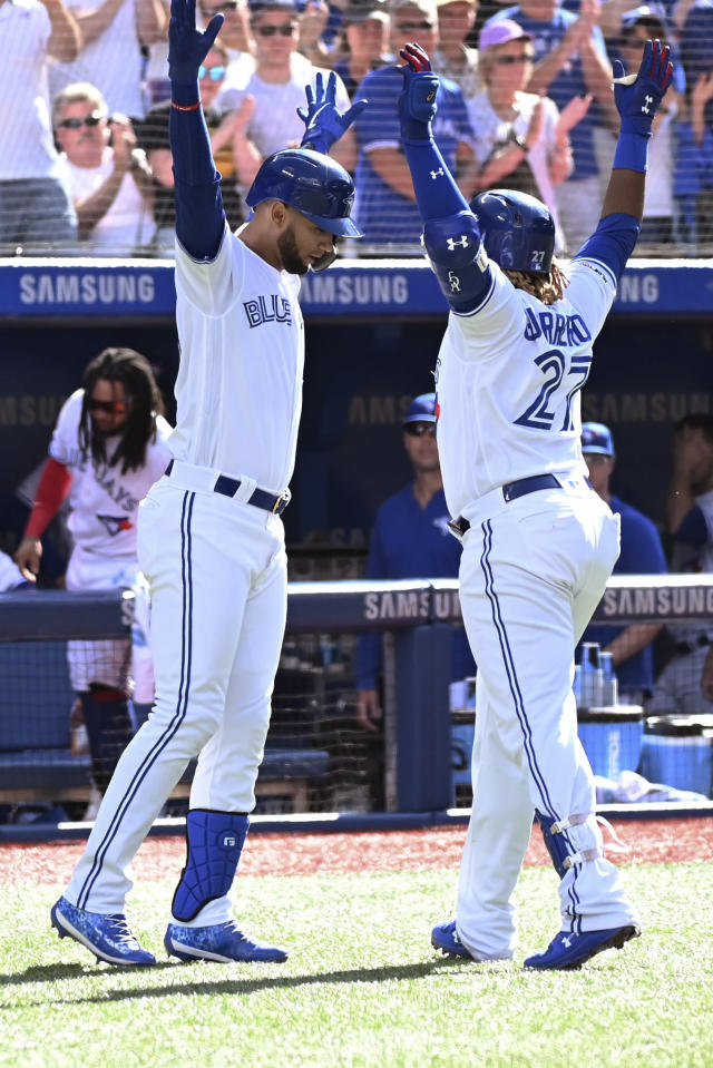 Toronto Blue Jays' Vladimir Guerrero Jr., right, celebrates with Lourdes Gurriel Jr. after hitting a solo home run against the Kansas City Royals during the third inning of a baseball game in Toronto on Saturday, June 29, 2019. (Jon Blacker/The Canadian Press via AP)