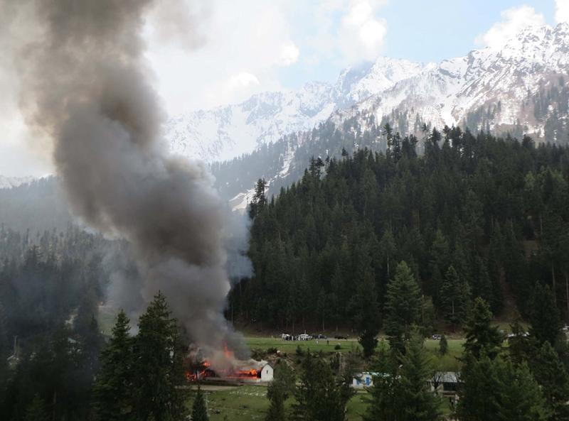 Smoke rises from the site where a Pakistani military helicopter crashed in Gilgit on May 8, 2015, killing seven people including the ambassadors from Norway and the Philippines (AFP Photo/Piar Ali)