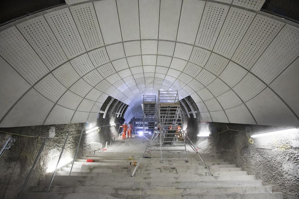 <p>Glass-fibre reinforced concrete panels line what will be the escalator at Bond Street station. </p>