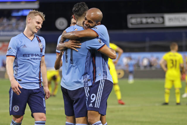 New York City FC forward Heber (9) celebrates with midfielder Valentin Castellanos, center, as midfielder Gary Macay-Steven, left, approaches the pair after Castellanos scored a goal during the first half of the team's MLS soccer match against the Columbus Crew, Wednesday, Aug. 21, 2019, in New York. (AP Photo/Kathy Willens)