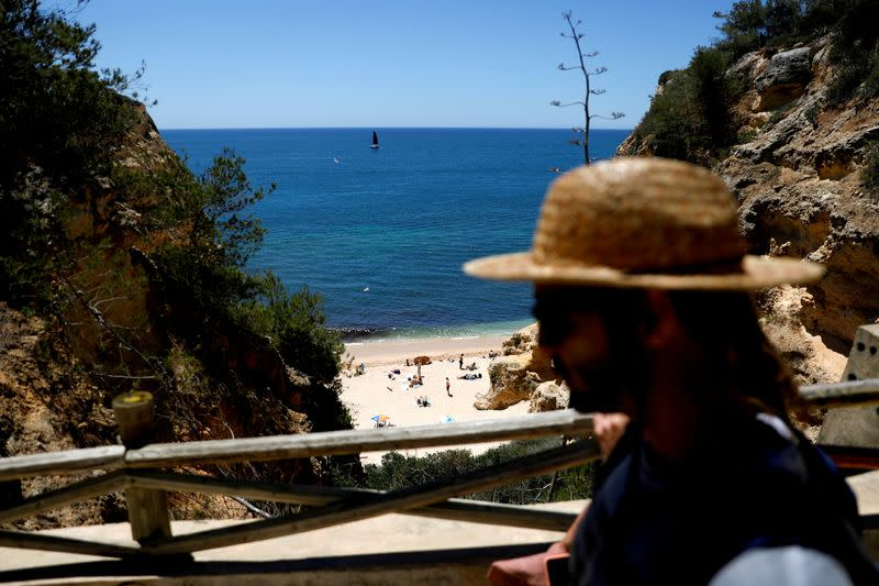 FILE PHOTO: People arrive at Marinha beach amid the COVID-19 pandemic in Albufeira