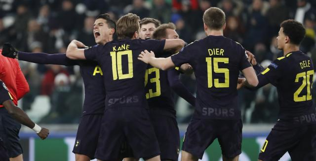 Christian Eriksen celebrates with teammates after scoring his side's second goal during the Champions League