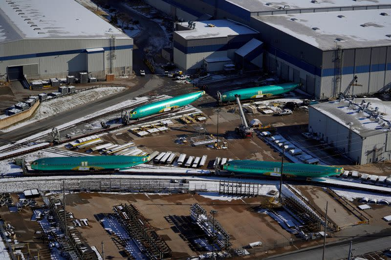 FILE PHOTO: Airplane fuselages bound for Boeing's 737 Max production facility await shipment on rail sidings at their top supplier, Spirit AeroSystems Holdings Inc, in Wichita