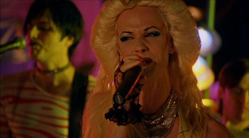 """<p><em>Hedwig and the Angry Inch</em> isn't actually based on a real person, but this rock musical captures the 1970s glam rock era perfectly, and is a great option for people who don't typically like """"musicals,"""" but loved <em>Hamilton</em>. It also stars John Cameron Mitchell (who wrote and created the show, much like Lin-Manuel Miranda who cast himself as the lead of his project) as a transgender punk performer who had her songs stolen by a former lover. </p><p><a class=""""link rapid-noclick-resp"""" href=""""https://www.amazon.com/gp/video/detail/amzn1.dv.gti.bea9f75d-0e8c-f014-2799-abdb05d30cfe?tag=syn-yahoo-20&ascsubtag=%5Bartid%7C10058.g.33594048%5Bsrc%7Cyahoo-us"""" rel=""""nofollow noopener"""" target=""""_blank"""" data-ylk=""""slk:WATCH IT"""">WATCH IT </a></p>"""
