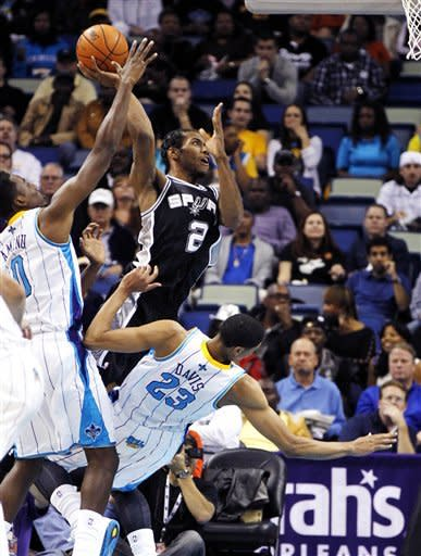 San Antonio Spurs small forward Kawhi Leonard (2) shoots over New Orleans Hornets power forward Anthony Davis (23) as Davis draws an offensive foul in the first half of an NBA basketball game in New Orleans, Wednesday, Oct. 31, 2012. (AP Photo/Gerald Herbert)
