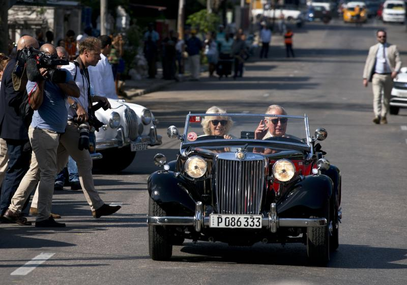 Prince Charles drives a vintage car with his wife Camilla, Duchess of Cornwall, during a cultural event in Havana, Cuba, Tuesday, March 26, 2019. The heir to the British throne arrived in Cuba Sunday with an agenda including visits to historic sites, a solar park, organic farm, bio-medical research center, a meeting with entrepreneurs, a cultural gala and a dinner with Cuba's president. (AP Photo/Ramon Espinosa)