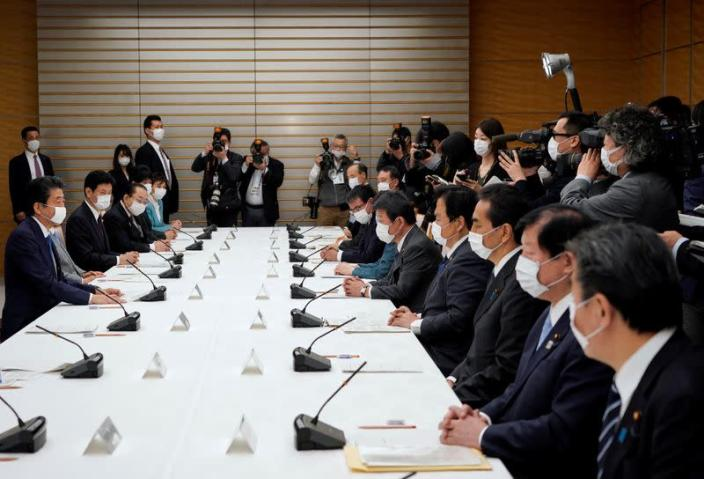 Japan's Prime Minister Shinzo Abe speaks during a meeting about the measures against the coronavirus disease (COVID-19), at the prime minister official residence in Tokyo