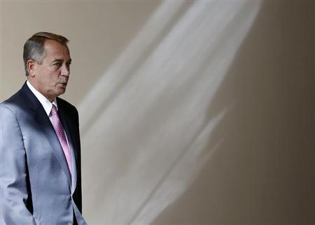 U.S. Speaker of the House John Boehner walks to his weekly news conference on Capitol Hill in Washington