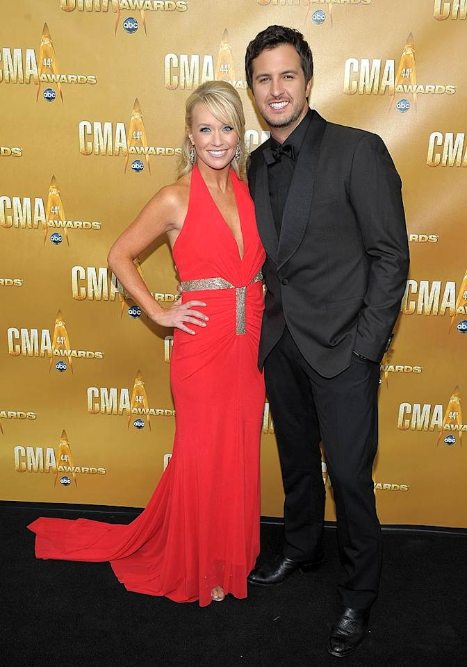 "New Artist of the Year nominee Luke Bryan, whose best known for his hit ""Rain Is a Good Thing,"" donned an all black ensemble, while his wife Caroline looked like a cast member of ""The Real Housewives of Orange County"" in her plunging gown, deep tan, and dyed 'do. Michael Loccisano/<a href=""http://www.wireimage.com"" target=""new"">WireImage.com</a> - November 10, 2010"