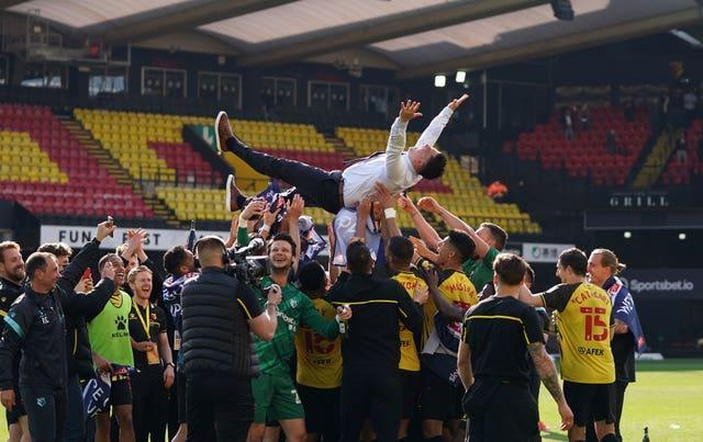 Watford head coach Xisco Munoz is thrown into the air by his players after guiding the club back into the Premier League at the first attempt