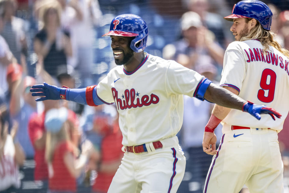 Philadelphia Phillies' Andrew McCutchen (22) celebrates at home plate with Travis Jankowski (9) after hitting a grand slam home run during the fifth inning of a baseball game against the Washington Nationals, Wednesday, June 23, 2021, in Philadelphia. (AP Photo/Laurence Kesterson)