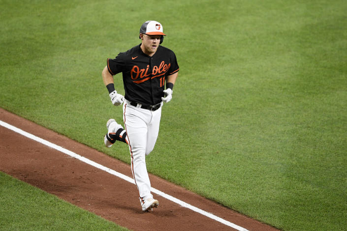 Baltimore Orioles' Pat Valaika jogs home after he hit a home run during the fifth inning of the team's baseball game against the Washington Nationals, Friday, July 23, 2021, in Baltimore. (AP Photo/Nick Wass)