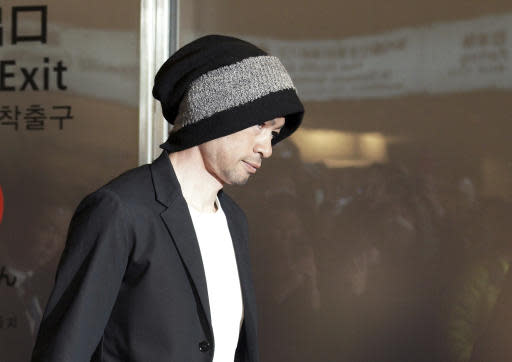 Seattle Mariners' Ichiro Suzuki walks upon his team's arrival at Haneda international airport in Tokyo Friday, March 15, 2019. The Mariners will play in a two-baseball game series against the Oakland Athletics to open the Major League season on March 20-21 at the Tokyo Dome. (AP Photo/Eugene Hoshiko)