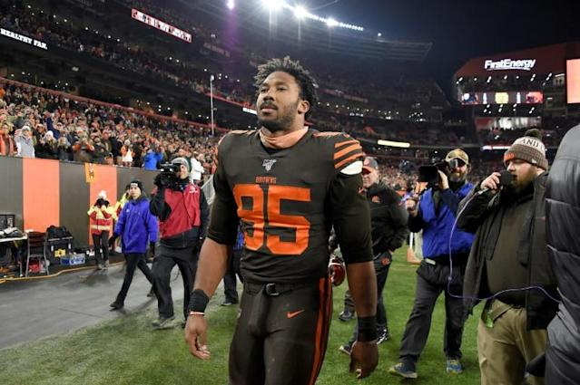 Defensive end Myles Garrett of the Cleveland Browns walks off the field after being ejected from the game at FirstEnergy Stadium (AFP Photo/Jason Miller)