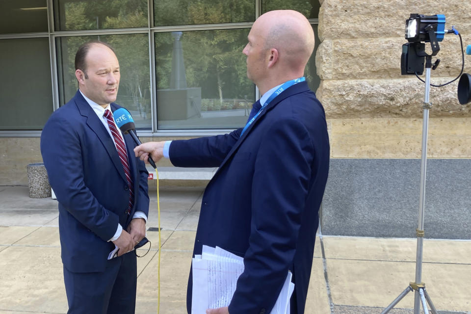 A reporter interviews acting U.S. Attorney Jonathan Lenzner outside the federal courthouse in Greenbelt, Md., on Wednesday, Sept. 15, 2021, after a judge sentenced Eric Eoin Marques to 27 years in prison. U.S. authorities have said Marques, 36, was the world's most prolific purveyor of child pornography when he was arrested in Ireland in 2013. (AP Photo/Michael Kunzelman)