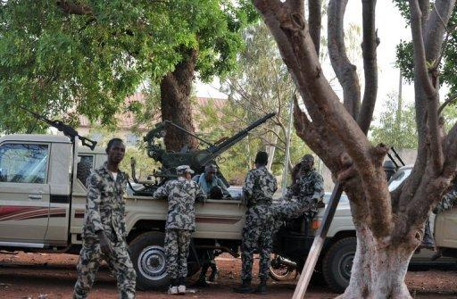 Malian soldiers stand guard on April 3, at the Kati military camp
