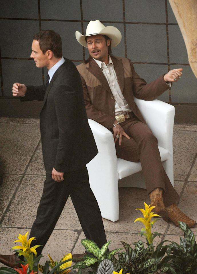 """<b>Brad Pitt Cowboys Up<br><br></b>If you can't immediately tell, that's no extra walking past Brad Pitt on the set of """"The Counselor"""" (seen here on Monday, July 31, in London). It's Michael Fassbender -- star of the film.<br><br>Fassbender plays a lawyer who quickly finds himself in deep water after becoming embroiled in the drug trade. Pitt plays a mysterious man who advises Fassbender's character.<br><br>The Ridley Scott film, due in theaters next year, will also feature the performances of Javier Bardem, Cameron Diaz and Penelope Cruz."""