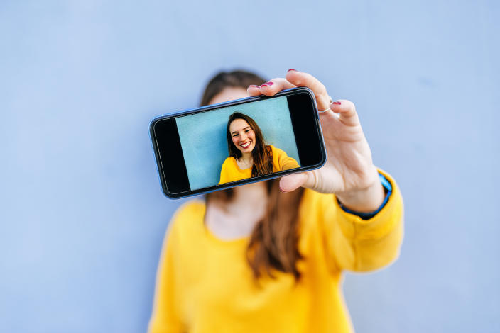 Be careful about sending selfies—photo scams are real. (photo: Getty)