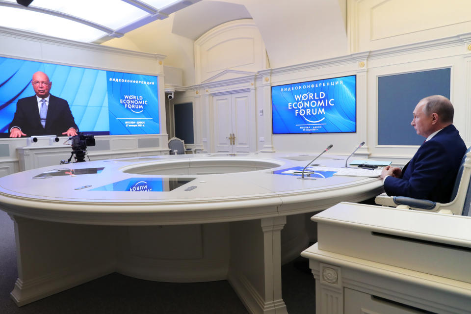 Russian President Vladimir Putin speaks to participants of the the World Economic Forum via a video link in Moscow, Russia, Wednesday, Jan. 27, 2021. Putin warned of rising global tensions and growing risks of new conflicts and called for broader international cooperation to tackle new challenges. (Mikhail Klimentyev, Sputnik, Kremlin Pool Photo via AP)
