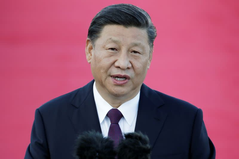 Chinese President Xi Jinping speaks following his arrival at Macau International Airport in Macau