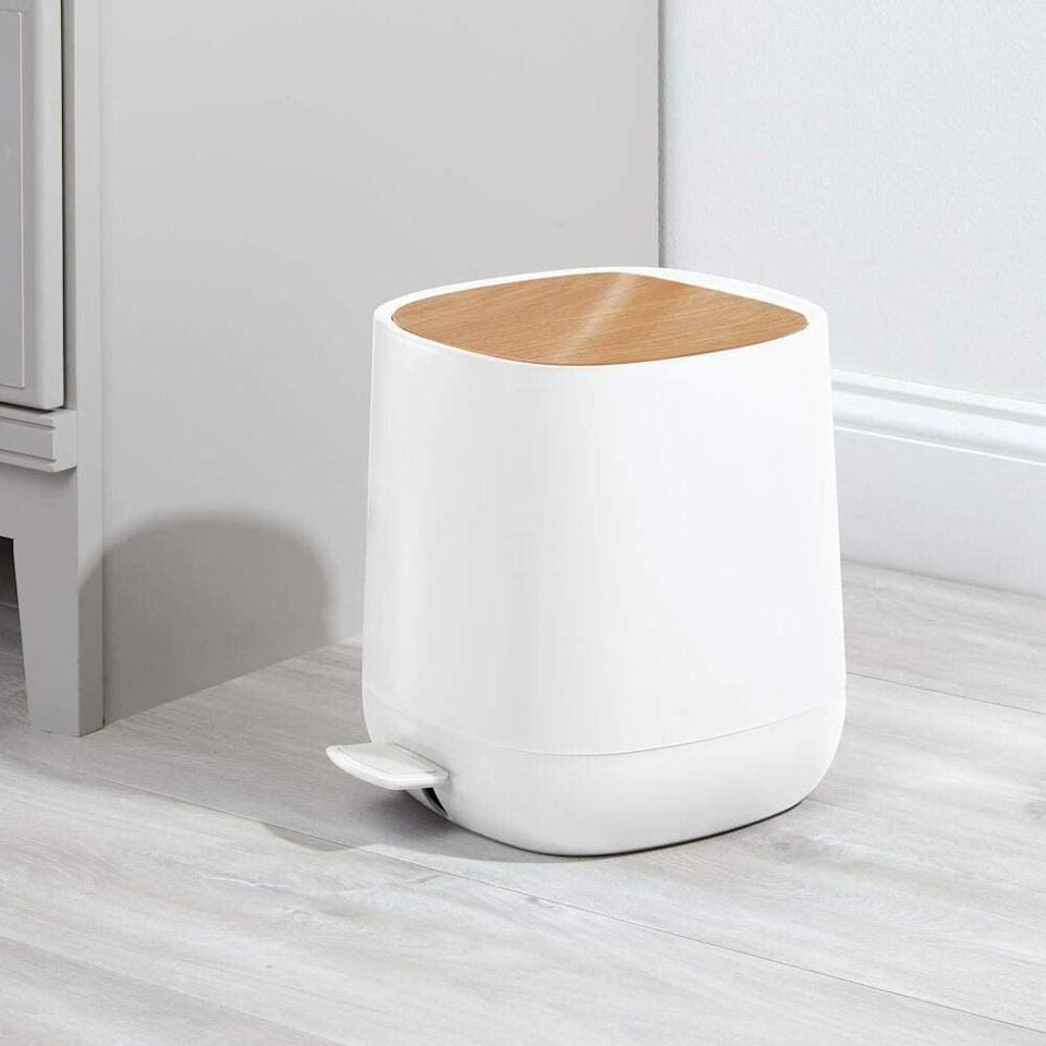 <p>If you want a sleek closed top choice for your bathroom, then try the <span>mDesign Modern Gallon Plastic Step Trash Can</span> ($35).</p>
