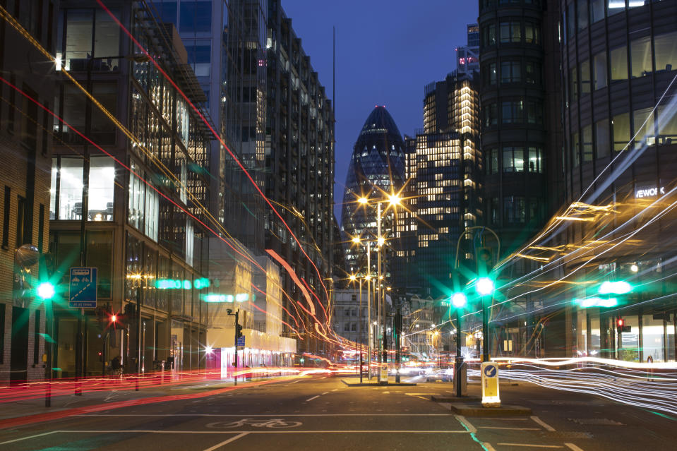 LONDON, ENGLAND - MARCH 20: Light trails left by traffic near Liverpool Street station on March 20, 2021 in London, England. A year since the British government issued its first stay-at-home order in response to the Covid-19 pandemic, on March 23, 2020, the City of London is still a ghost town of shuttered shops and restaurants, scarcely populated offices, and negligible tourist traffic. Even as the UK prepares to ease the current lockdown measures, a sense of normality in  the city's historic financial district feels a long way off. (Photo by Dan Kitwood/Getty Images)
