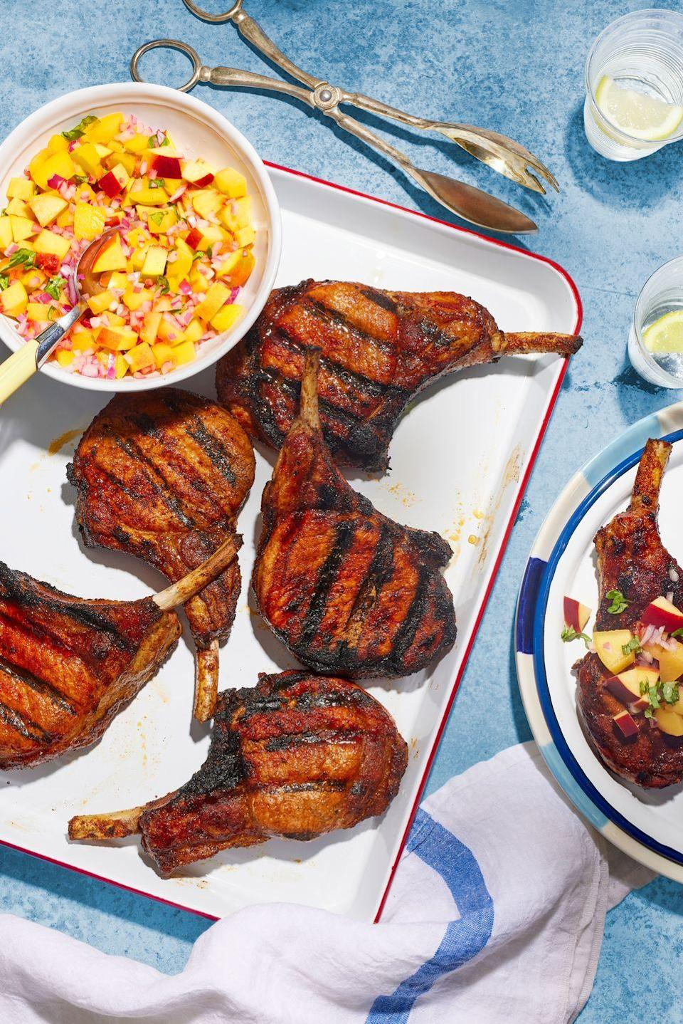 """<p>These spicy-sweet chops get lots of flavor from being grilled, and pair perfectly with a fresh summer peach relish.</p><p><strong><a href=""""https://www.countryliving.com/food-drinks/a36751653/smoky-grilled-dry-rub-pork-chops-recipe/"""" rel=""""nofollow noopener"""" target=""""_blank"""" data-ylk=""""slk:Get the recipe"""" class=""""link rapid-noclick-resp"""">Get the recipe</a>.</strong></p>"""
