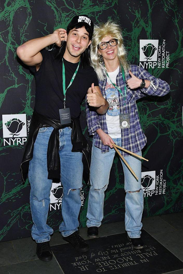 """<p>If you're ready to party on with your partner on Halloween, then dressing up as Garth and Wayne from <em>Wayne's Worl</em><em>d</em> is the way to go.</p><p><a class=""""link rapid-noclick-resp"""" href=""""https://www.amazon.com/Waynes-World-Garth-Wig-Glasses/dp/B01LZYQJ3M?tag=syn-yahoo-20&ascsubtag=%5Bartid%7C10070.g.1923%5Bsrc%7Cyahoo-us"""" rel=""""nofollow noopener"""" target=""""_blank"""" data-ylk=""""slk:SHOP MULLET AND GLASSES"""">SHOP MULLET AND GLASSES</a></p><p><a class=""""link rapid-noclick-resp"""" href=""""https://www.amazon.com/Waynes-costume-embroidered-baseball-version/dp/B00B7WR2LU?tag=syn-yahoo-20&ascsubtag=%5Bartid%7C10070.g.1923%5Bsrc%7Cyahoo-us"""" rel=""""nofollow noopener"""" target=""""_blank"""" data-ylk=""""slk:SHOP BLACK HAT"""">SHOP BLACK HAT</a></p>"""