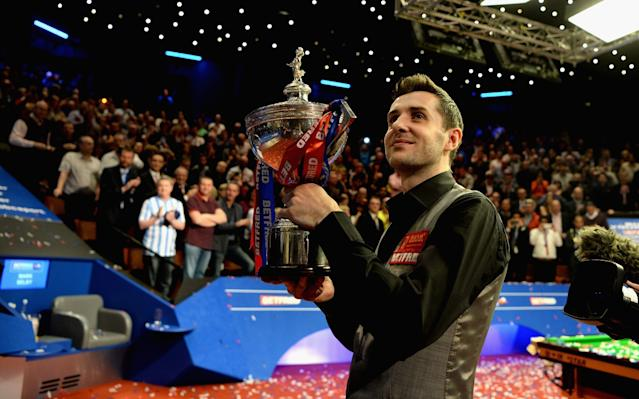 Mark Selby holds the trophy aloft