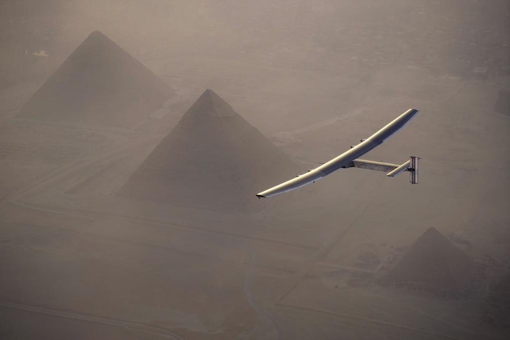 Solar Impulse 2 flys over the pyramids of Giza on July 13, 2016 prior to landing in Cairo, Egypt (AFP Photo/Jean Revillard)