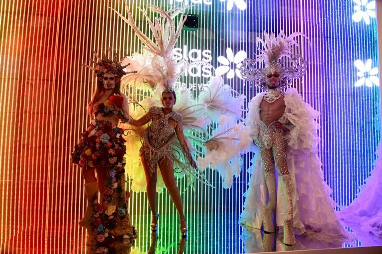 Models dressed for the Canary Islands carnival perform at the International Tourism Fair in Madrid