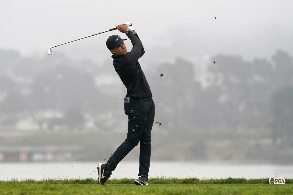 Cameron Champ watches his tee shot on the 15th hole during the third round of the PGA Championship golf tournament at TPC Harding Park Saturday, Aug. 8, 2020, in San Francisco. (AP Photo/Jeff Chiu)