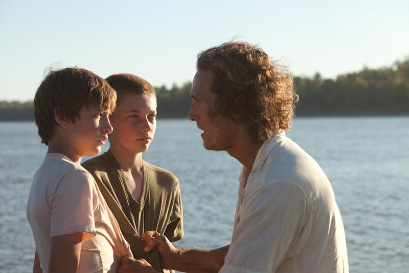"This film image released by Roadside Attractions shows Tye Sheridan, left, Jacob Lofland, and Matthew McConaughey, right, in a scene from ""Mud."" (AP Photo/Roadside Attractions, Jim Bridges)"