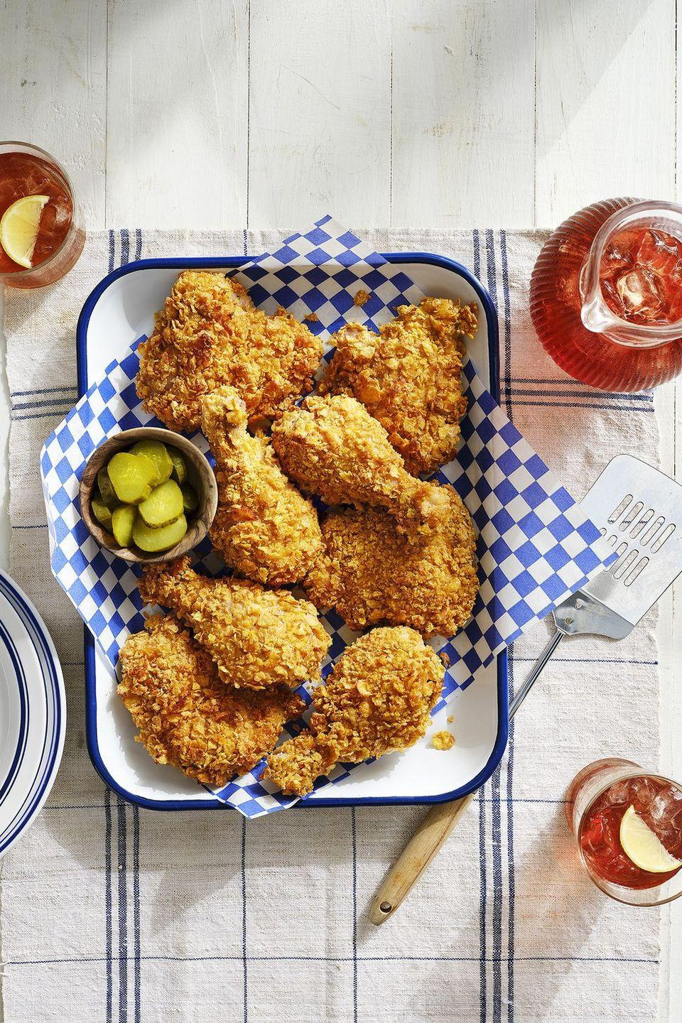 """<p>This crunchy, yummy fried chicken alternative is sure to satisfy, but without nearly the effort (or the calories) that <em>actual</em> fried chicken involves.</p><p><strong><a href=""""https://www.countryliving.com/food-drinks/a30417464/cornflake-crusted-baked-chicken-recipe/"""" rel=""""nofollow noopener"""" target=""""_blank"""" data-ylk=""""slk:Get the recipe"""" class=""""link rapid-noclick-resp"""">Get the recipe</a>.</strong></p><p><a class=""""link rapid-noclick-resp"""" href=""""https://www.amazon.com/Nordic-Ware-Natural-Aluminum-Commercial/dp/B0049C2S32/?tag=syn-yahoo-20&ascsubtag=%5Bartid%7C10050.g.4772%5Bsrc%7Cyahoo-us"""" rel=""""nofollow noopener"""" target=""""_blank"""" data-ylk=""""slk:SHOP BAKING SHEETS"""">SHOP BAKING SHEETS</a></p>"""
